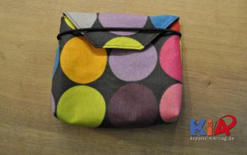 Kleines Täschlein: Tasche Lüttje aus Wachstuch und Baumwolle